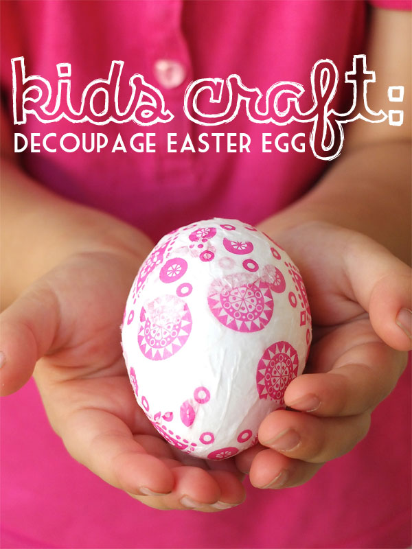Girl wearing pink holding an easter egg
