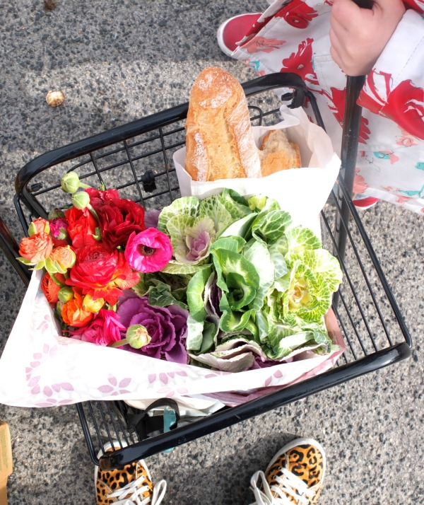 shopping trolley with bread and flowers