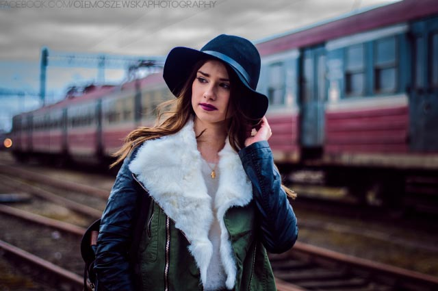 Girl portrait photograph on railway track with hat