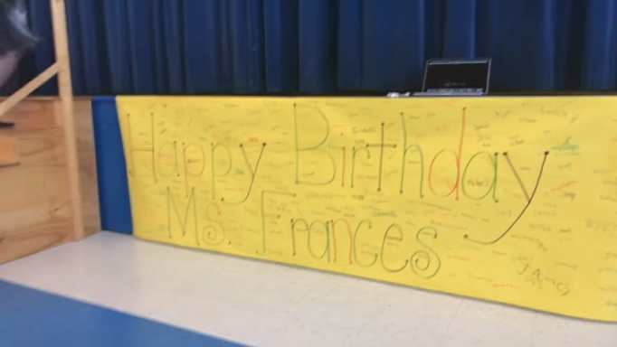 """A banner bearing the words """"Happy Birthday Miss Frances"""""""