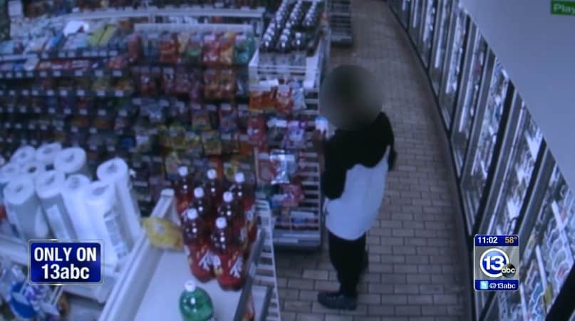 The teen grabbing items from the shelves