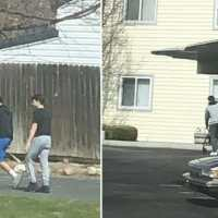 Elderly man falls on the sidewalk, teenagers pick him up and walk him back home