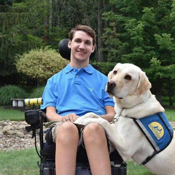 Michael Cantu and Toli the service dog