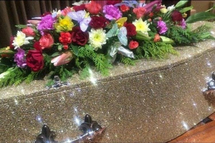 sparkly coffin with flowers