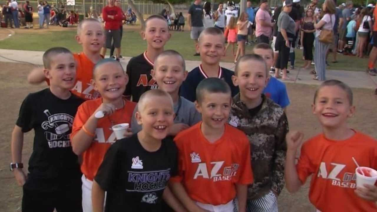 Boys cheering for their friend with cancer