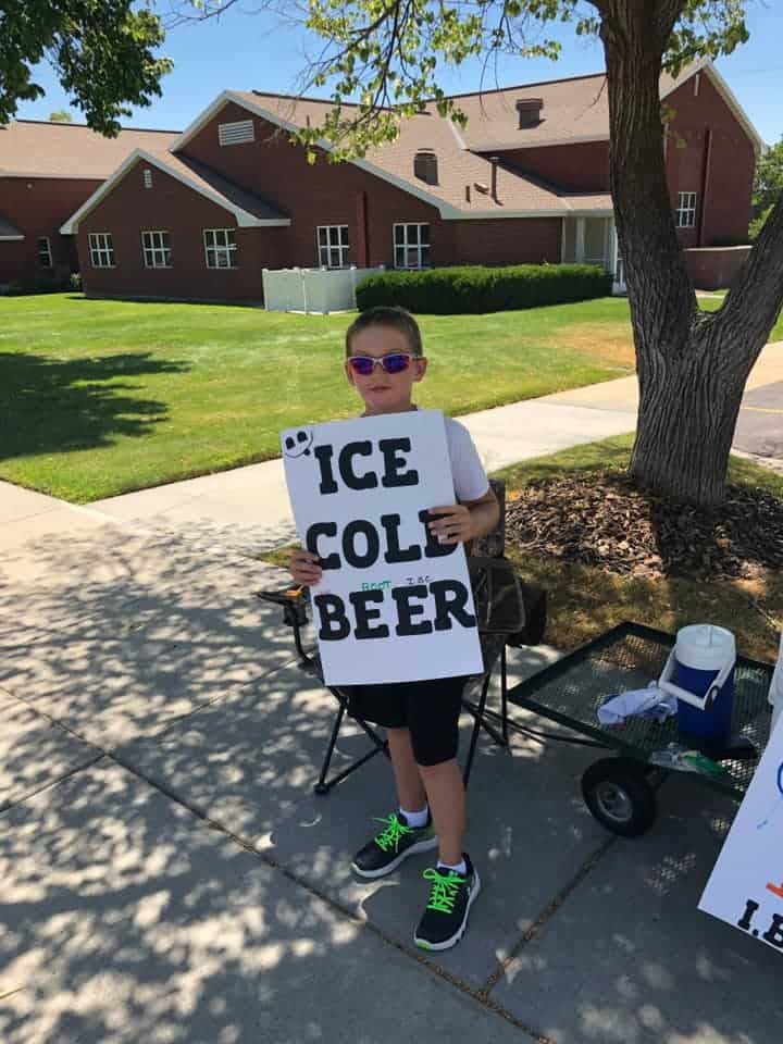 boy sells ice cold root beer