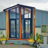This family home is two tiny homes connected by a gorgeous sunroom, take a look inside
