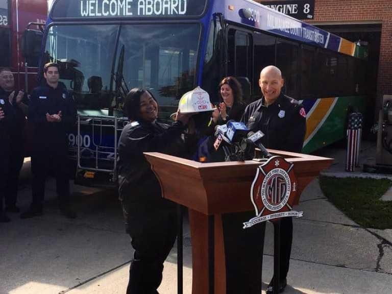 Chanaye Brown receiving her award from Milwaukee Fire Department