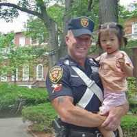Harvard University officer recreates photo with girl he met 15 years ago