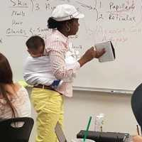 A professor held her student's baby while giving a 3-hour lecture so the mother could take notes