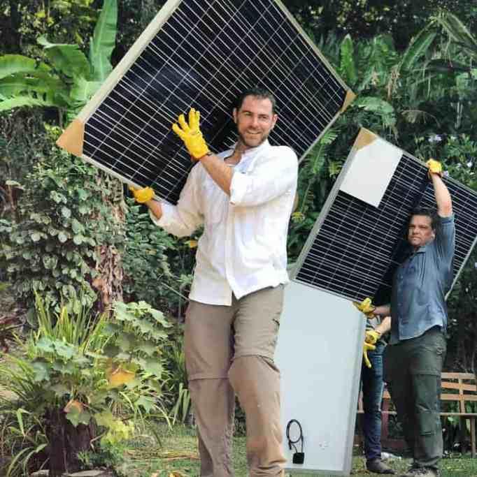 solar power farm being installed by volunteers
