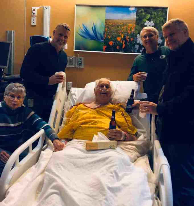 Man with colon cancer having his final beer with sons