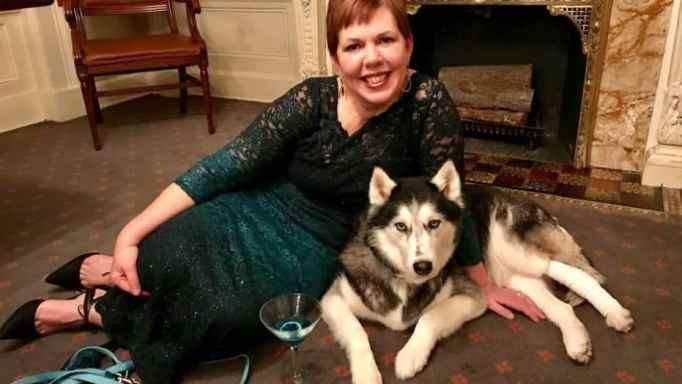 Stephanie Herfel smiling with her dog Sierra