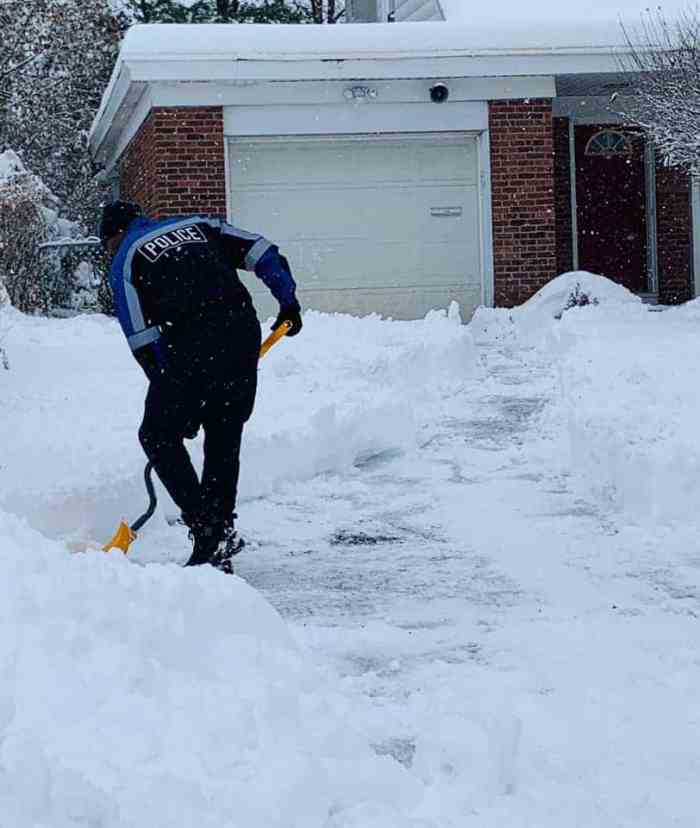 Cops shovel snow from elderly woman's home living alone.