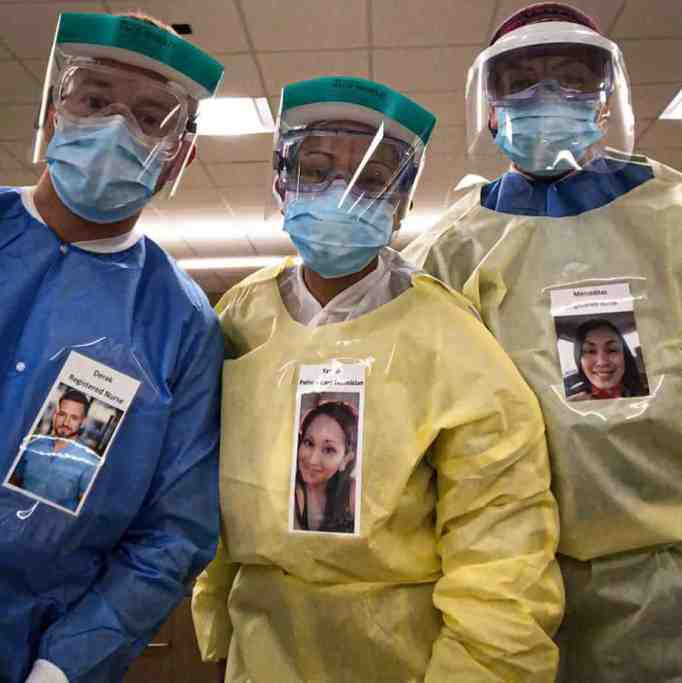 ER hospital staff wearing photos of themselves smiling to comfort patients.