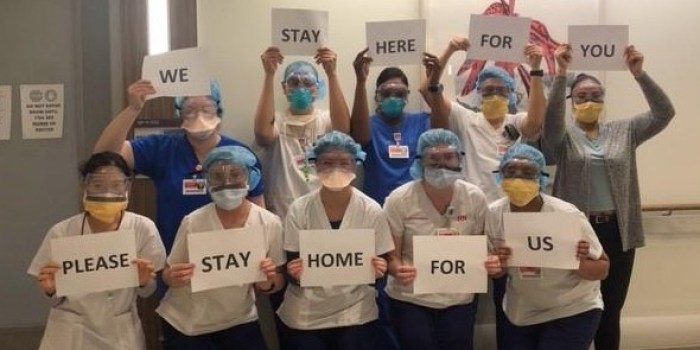Doctors and nurses at NewYork-Presbyterian Queens Hospital encouraging everyone to stay home