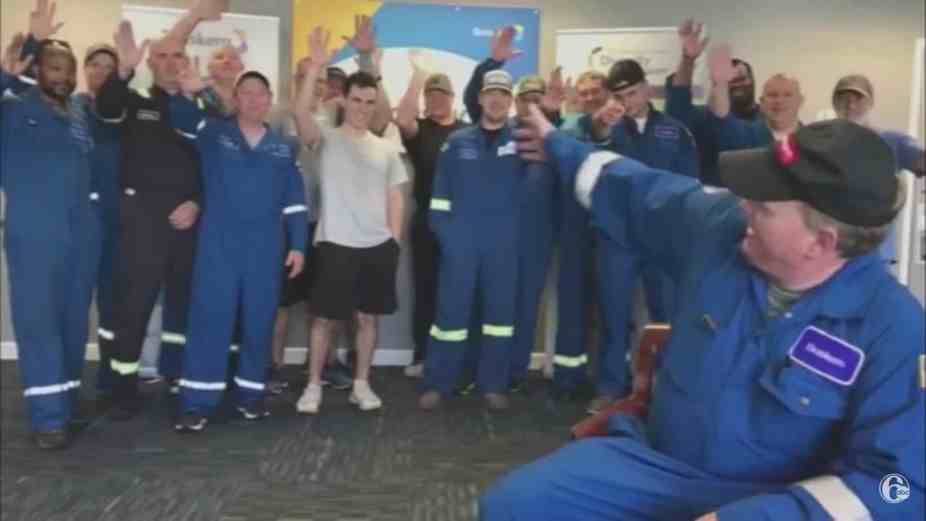 Workers in a chemical company waving.