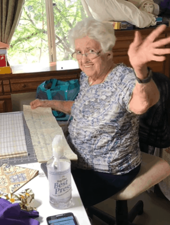Grandma listen to Beatles while sewing.