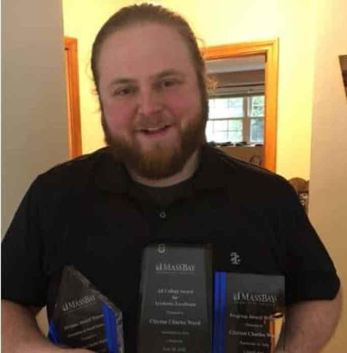 Clayton Ward receives his awards