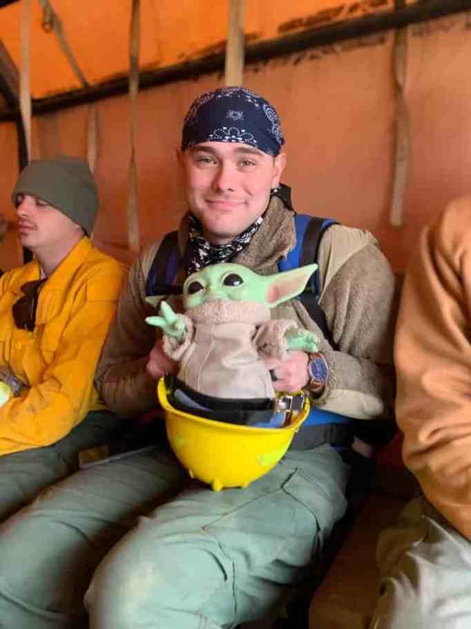 A man holding Baby Yoda