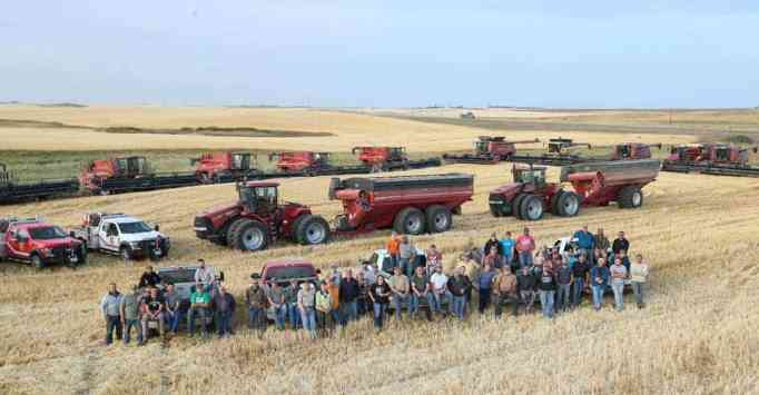 The farmers posing for a group photo.