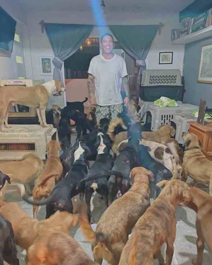 Ricardo Pimentel with the stray dogs he welcomed in his home