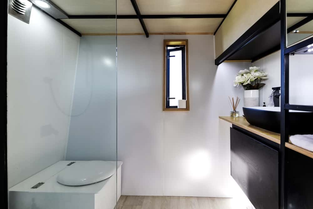 Epic modern all black tiny home with beautiful house interior.