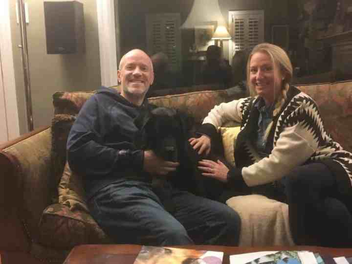 Capone the Labrador retriever mix together with his new family