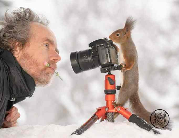 Geert Weggen pictured with a camera and a squirrel