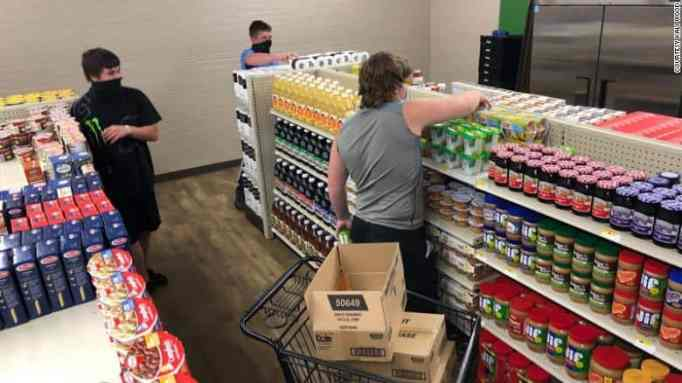 Students picking items in this high school's unique grocery story.