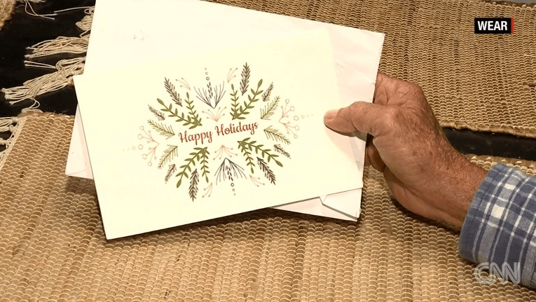 Holiday card that was sent to families whose bills Michael Esmond paid last year in Gulf Breeze, Florida