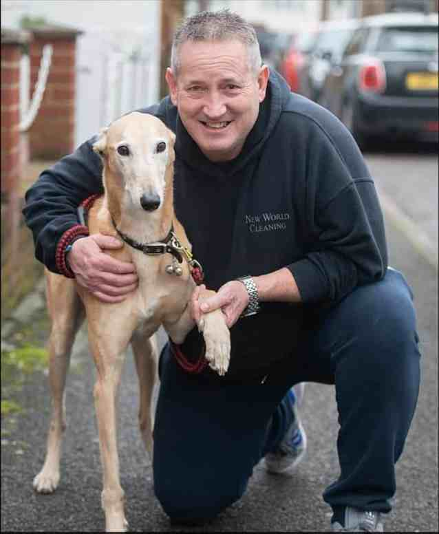 A Lurcher dog and his male owner