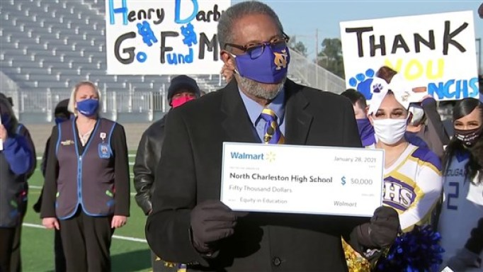 North Charleston High School holding a $50,000 check from Walmart