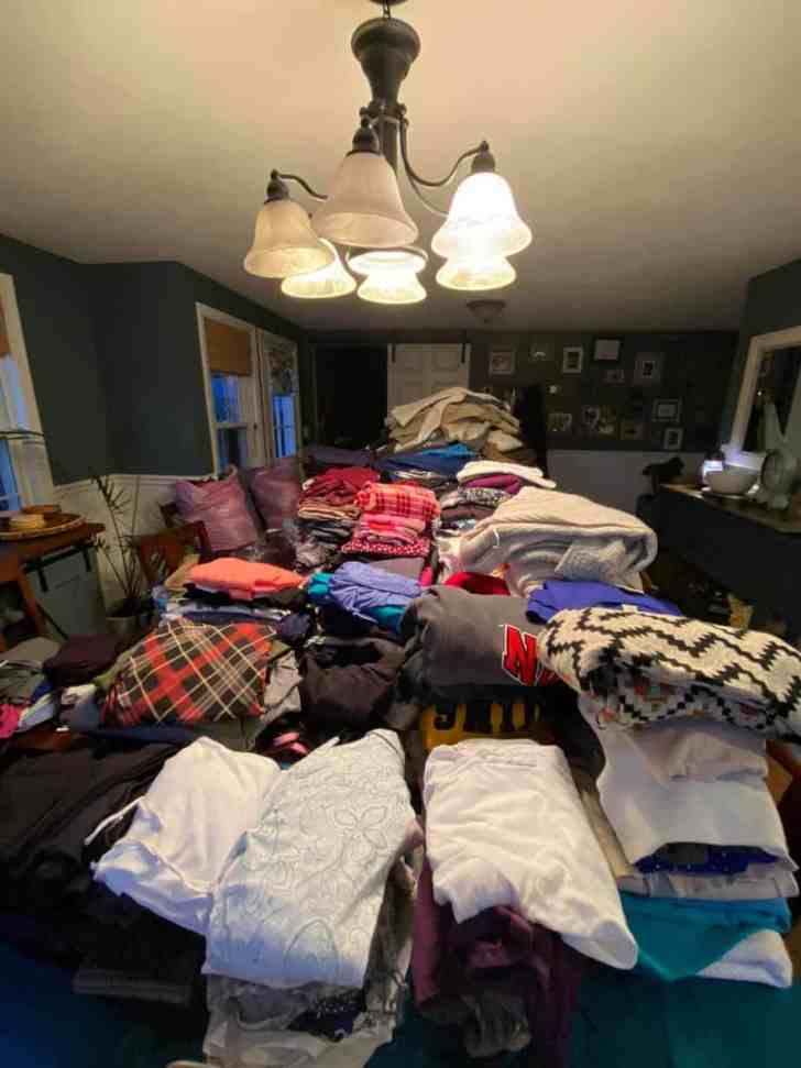 Piles of donated clothing items