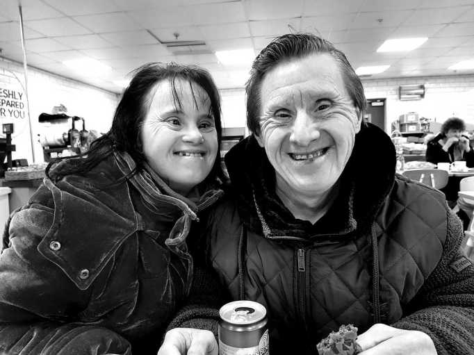 Maryanne and Tommy enjoying a meal at a restaurant.