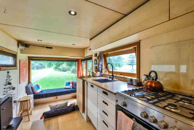 The kitchen and living room of a tiny house truck