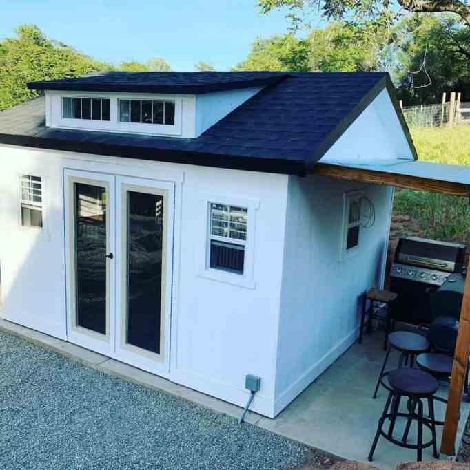 A white colored bar shed : modern backyards