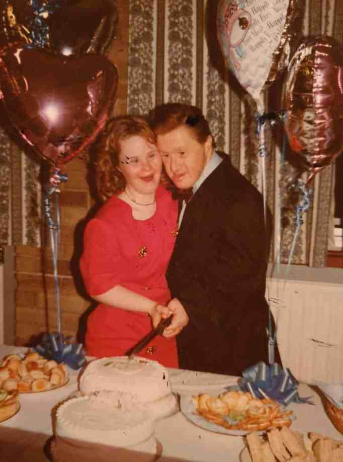 Maryanne and Tommy cutting the cake at their engagement party.