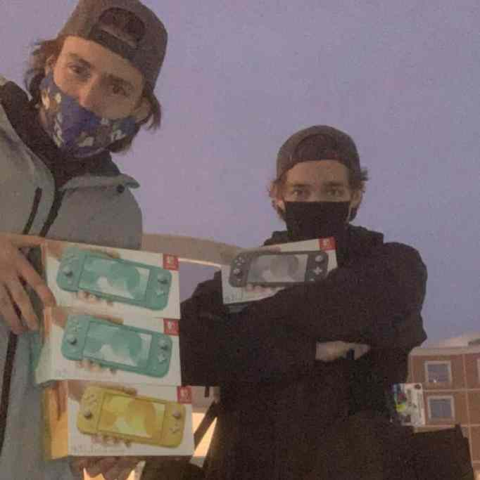 Hunter Kahn and a friend holding the Nintendo Switches that will be donated to Children's Minnesota hospital