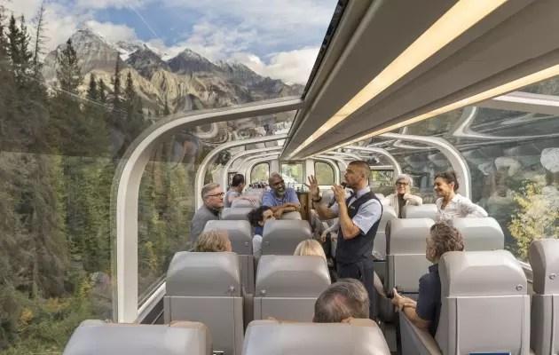 Tourists inside a glass-domed train