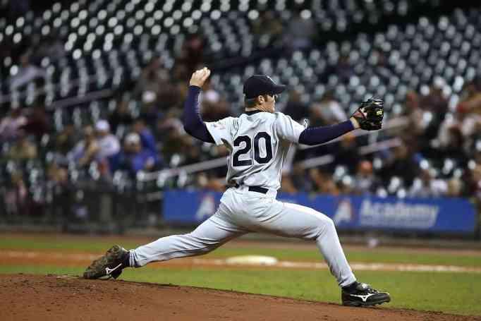 A baseball player pitching