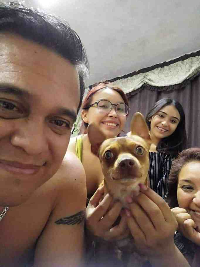A family with their tiny dog