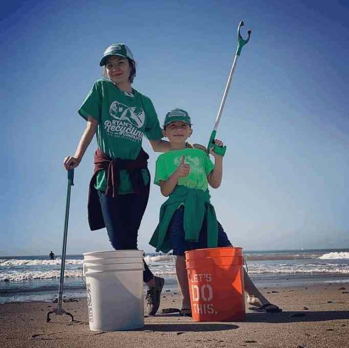 Ryan, ready to pick up trash on the beach. His recycling company will keep them from polluting the ocean.