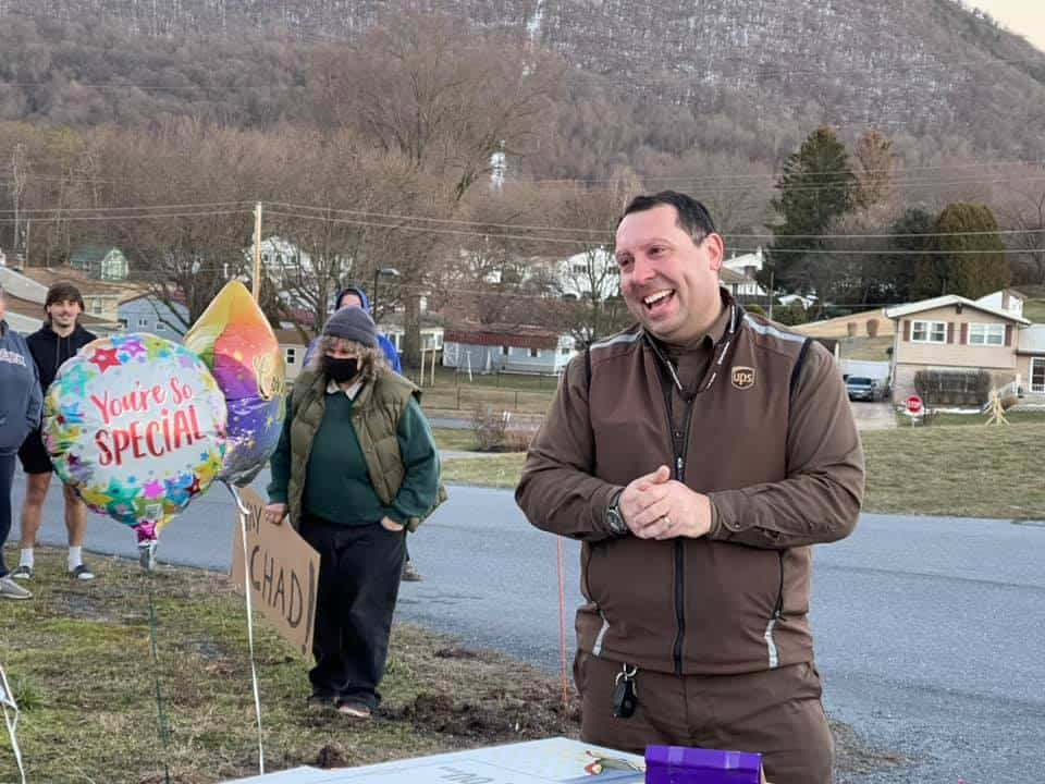 UPS driver Chad Turns smiling at his surprise thank you party