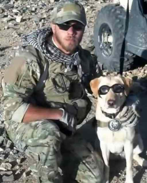 Sgt. Tom Hansen with his canine partner Taylor in Afghanistan