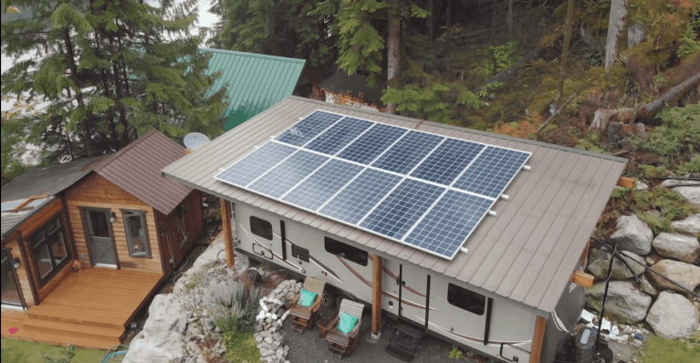 The off the grid home has panels for solar energy