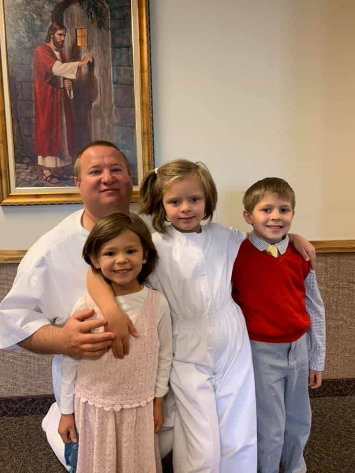 Daryl Andersen and the three siblings he adopted