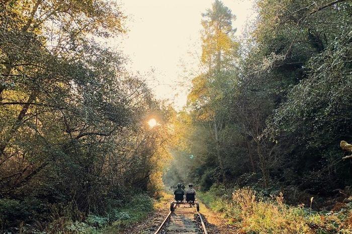 A couple riding a railbike
