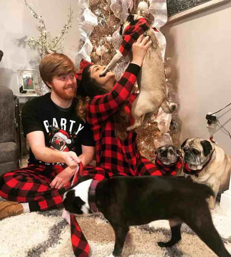 Sonya Karimi and Zach Grate with their dogs