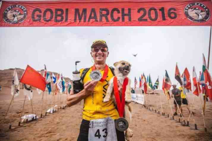 Dion Leonard and Gobi with their medals